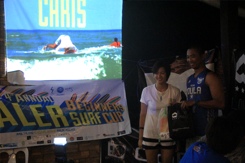 Chris Receiving an award for Headstanding while Surfing